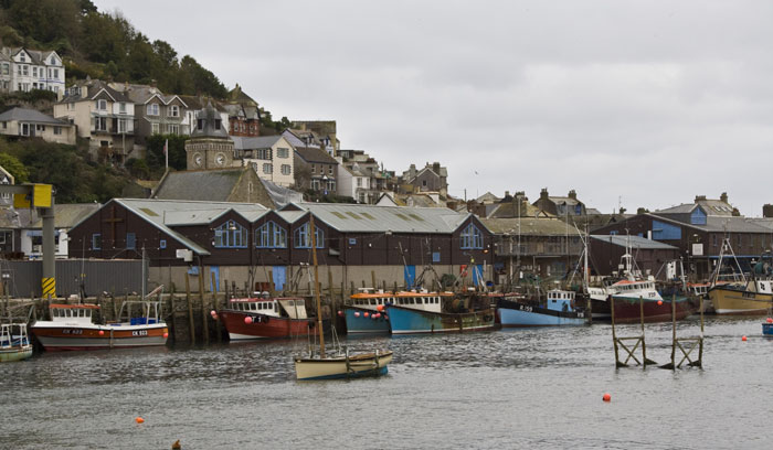 Fishing boats tied up on the east looe quayside